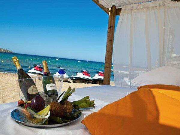 champagne pebbles beach bar radisson blu resort and spa malta golden sands