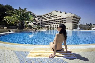 relaxing by the pool grand-hotel excelsior floriana malta