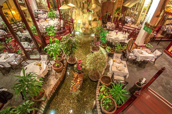 blue elephant thai cuisine interior with fish pond hilton malta hotel